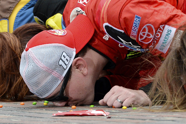 Las Vegas native Kyle Busch kisses the bricks on the start/finish line after winning the Crown Royal 400 at Indianapolis Motor Speedway on Sunday. (Jasen Vinlove/USA Today)
