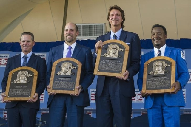 From left, Craig Biggio, John Smoltz, Randy Johnson and Pedro Martinez pose for photos during the Hall of Fame induction ceremony in Cooperstown, N.Y., on Sunday. (Gregory J. Fisher/USA Today)