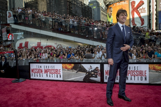 "Actor Tom Cruise poses on the red carpet for a screening of the film ""Mission Impossible: Rogue Nation"" in New York July 27, 2015. REUTERS/Brendan McDermid"
