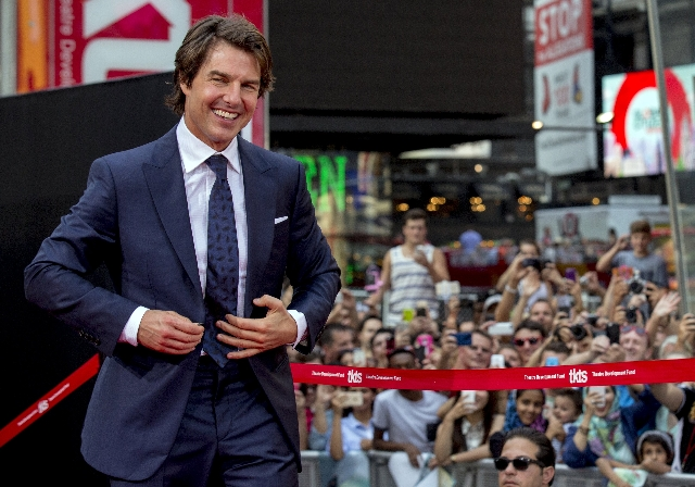 "Actor Tom Cruise poses on the red carpet for a screening of the film ""Mission Impossible: Rogue Nation"" in New York July 27, 2015. (Brendan McDermid/Reuters)"