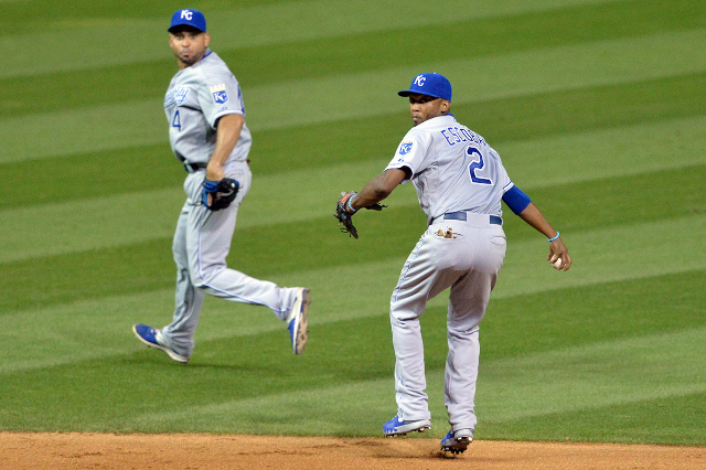 Jul 28, 2015; Cleveland, OH, USA; Kansas City Royals second baseman Omar Infante (14) flips the ball to shortstop Alcides Escobar (2) who then threw to first base for a putout of Cleveland Indians ...