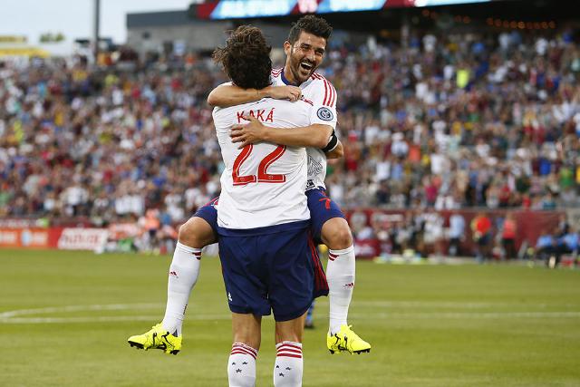 Jul 29, 2015; Denver, CO, USA; MLS All Stars forward David Villa (7) of the New York City FC celebrates with midfielder Kaka (22) of Orlando City SC during the first half of the 2015 MLS All Star  ...