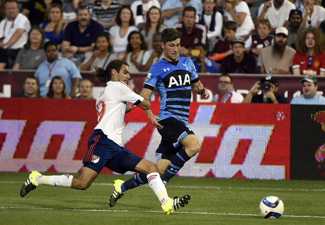 Jul 29, 2015; Denver, CO, USA; MLS All Star midfielder Graham Zusi (19) of Sporting Kansas City defends against Tottenham Hotspur defender Ben Davies (33) during the first half of the 2015 MLS All ...