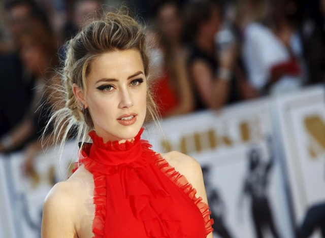 "Actress Amber Heard poses at the European premiere of ""Magic Mike XXL"" at Leicester Square in London, Britain June 30, 2015. (Luke MacGregor/Reuters)"