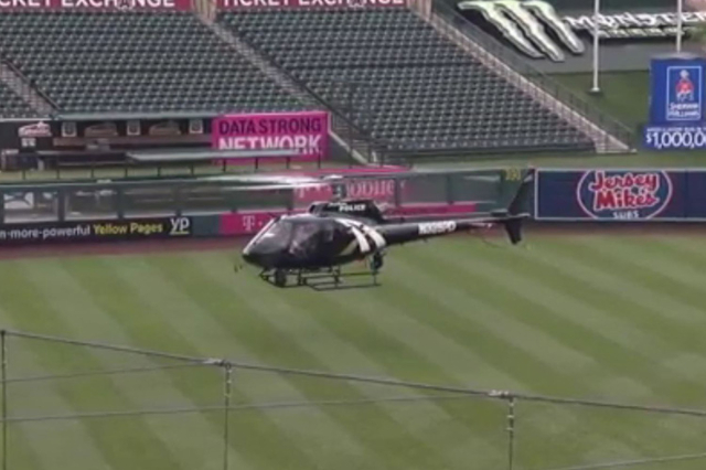 The Angels brought in a local police helicopter Monday morning to hover over the field and help dry out the turf. (Screengrab/Fox Sports/NDN)