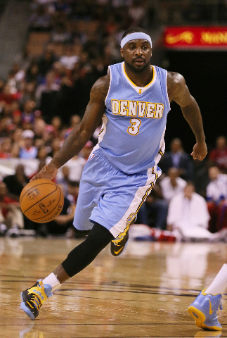 Denver Nuggets' guard Ty Lawson drives the ball during a preseason game against the Los Angeles Clippers at Mandalay Bay hotel-casino Saturday, Oct. 18, 2014, in Las Vegas. (Ronda Churchill/Las  ...
