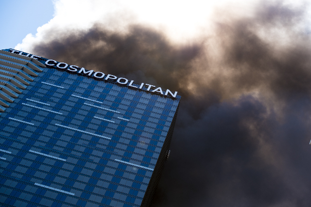 Smoke billows from a fire at the pool of The Cosmopolitan hotel-casino on the strip in Las Vegas on Saturday, July 25, 2015. (Joshua Dahl/Las Vegas Review-Journal)