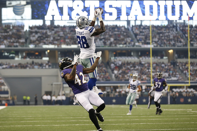 Aug 16, 2014; Arlington, TX, USA; Dallas Cowboys receiver Dez Bryant (88) catches a touchdown pass in the first quarter against Baltimore Ravens cornerback Dominque Franks (42) at AT&T Stadium. (M ...