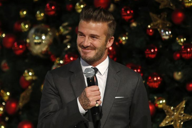 David Beckham speaks before launching Christmas lights at the Marina Bay Sands shopping mall in Singapore November 15, 2014. (Edgar Su/Reuters)