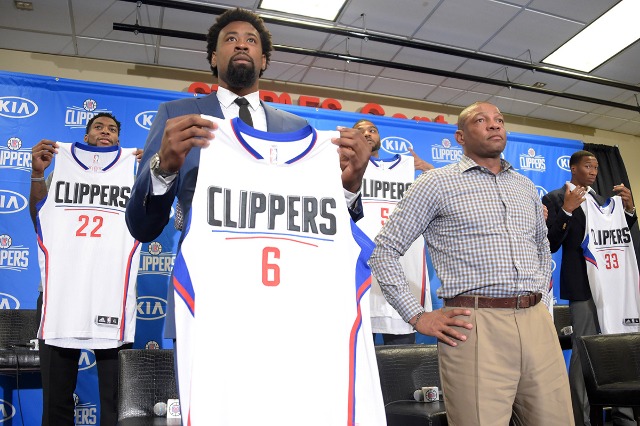 Jul 21, 2015; Los Angeles, CA, USA; Los Angeles Clippers center DeAndre Jordan (left) and coach Doc Rivers at press conference at Staples Center. (Kirby Lee/USA Today Sports)