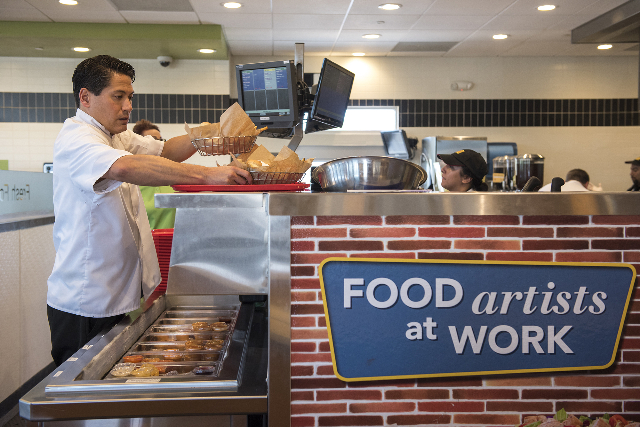 Operating Director Tobias Fox prepares a customer's meal inside PDQ restaurant at 3737 W. Craig Rd. in North Las Vegas on Friday, May 29, 2015. (Martin S. Fuentes/Las Vegas Review-Journal)