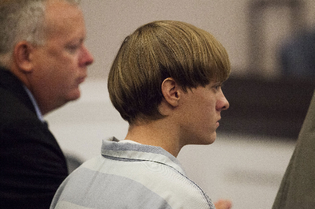 Dylann Roof, right, the 21-year-old man charged with murdering nine worshippers at a historic black church in Charleston last month, listens to the proceedings with assistant defense attorney Will ...