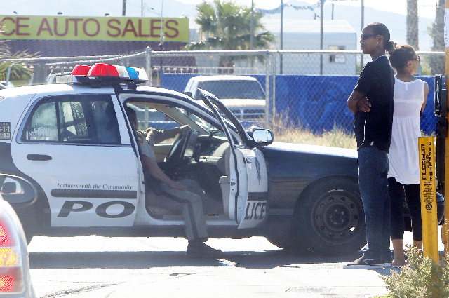 Residents watch as Las Vegas police investigate a fatal shooting at the Ridge Falls apartment complex in the 2800 block of East Charleston, Tuesday, July 21, 2015. (Bizuayehu Tesfaye/Las Vegas Rev ...