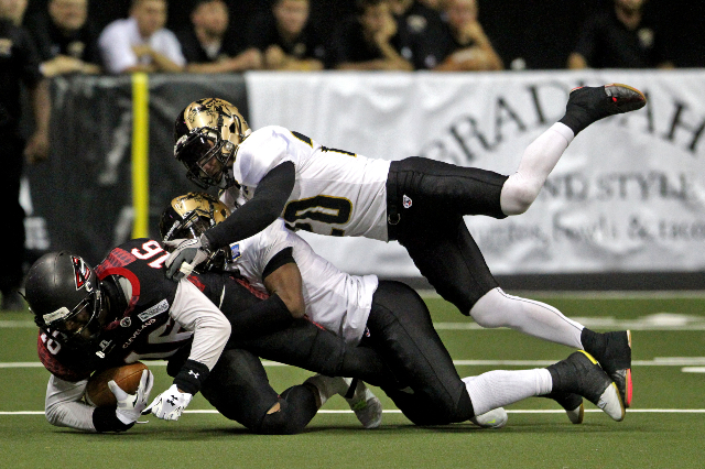 Dominick Goodman of the Cleveland Gladiators is tackled during the first quarter on Sunday, June 7, 2015, in Las Vegas. The Outlaws lost to the Gladiators 63 to 44. (James Tensuan/Las Vegas-Review ...