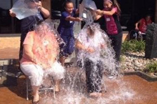 An organization in Topeka, Kansas, completed the Ice Bucket Challenge and honored one of its former staff members who suffers with ALS on Aug. 20, 2014. More than 17 million people around the Unit ...