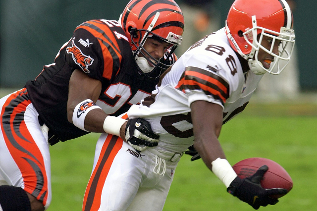 Former Cleveland Browns wide receiver Jaun Dawson (R) fights to break free from Cincinnati Bengals' corner back Artrell Hawkins (L) for extra yardage during the first quarter of play Septemb ...
