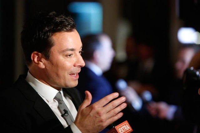 Television show host Jimmy Fallon talks to reporters on the red carpet for the taping of the Mark Twain Prize for Humor ceremony and performance at the Kennedy Center in Washington October 19, 201 ...