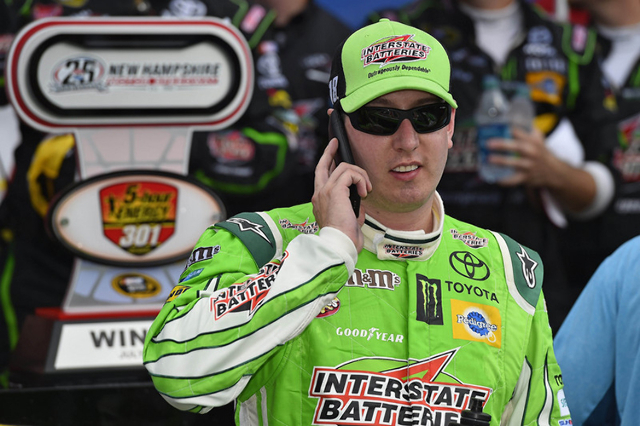 Jul 19, 2015; Loudon, NH, USA; NASCAR Sprint Cup Series driver Kyle Busch talks on the phone with president of Joe Gibbs Racing J.D. Gibbs (not pictured) after winning 5-Hour Energy 301 at New Ham ...