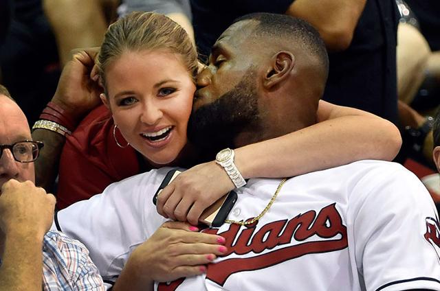 LeBron James kisses Kristen Ledlow of NBA TV during Summer League action Friday at the Thomas & Mack Center. (David Becker/Las Vegas Review-Journal)