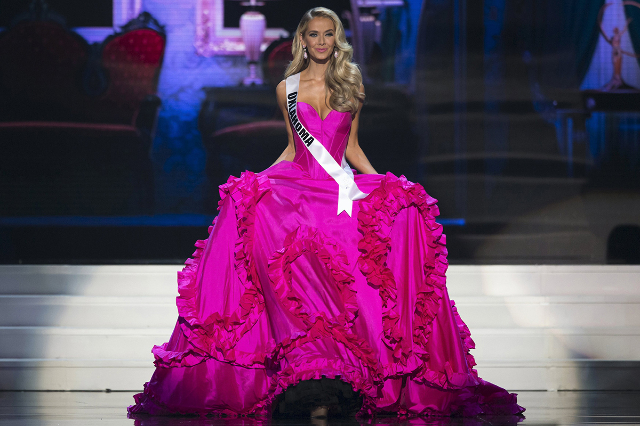 Newly crowned Miss USA Olivia Jordan of Oklahoma walks in her evening gown on stage during the 2015 Miss USA beauty pageant in Baton Rouge, Louisiana July 12, 2015. Fifty-one state titleholders co ...