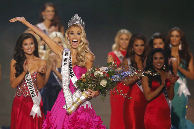 Newly crowned Miss USA Olivia Jordan of Oklahoma reacts after winning the 2015 Miss USA beauty pageant in Baton Rouge, Louisiana July 12, 2015. Fifty-one state title holders competed in the swimsu ...