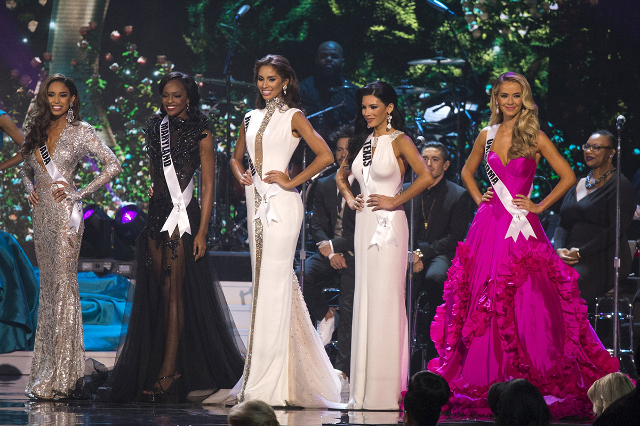 The top five contestants are seen in their evening gowns during the 2015 Miss USA beauty pageant in Baton Rouge, Louisiana July 12, 2015. Standing from left to right is Miss Nevada Brittany McGowa ...