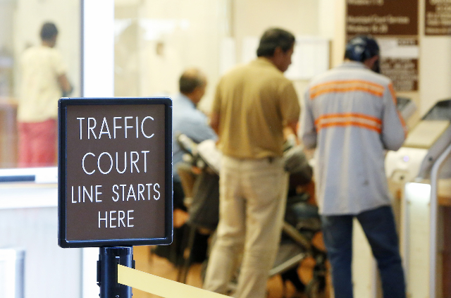 People are seen at the Municipal Court payment counter on the first floor of Regional Justice Center on Friday, June 12, 2015.  (Bizuayehu Tesfaye/Las Vegas Review-Journal) Follow Bizu Tesfaye on  ...