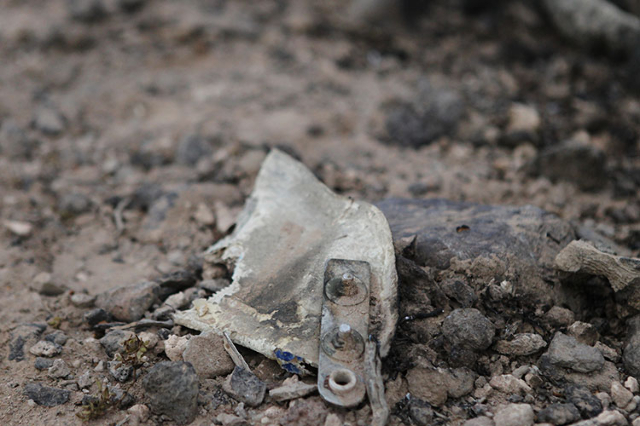 Debris from a plane crash is seen at the scene of the crash in the outskirts of Henderson near Savella Avenue and Via Firenze Avenue on Sunday, July 19, 2015. (Erik Verduzco/Las Vegas Review-Journ ...
