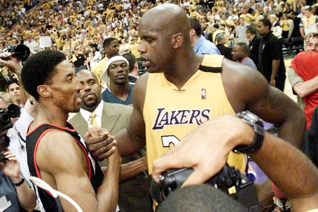 Los Angeles Lakers' Shaquille O'Neal (R) exchanges words with Portland Trail Blazers Scottie Pippen (L) after Game 7 of the Western Conference Finals at the Staples Center in Los Angel ...