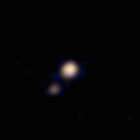 An image of Pluto and its largest moon, Charon, taken by the Ralph color imager aboard NASA's New Horizons spacecraft. (Courtesy, CNN)