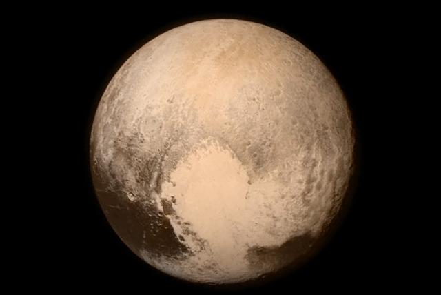 One of the final images taken before New Horizons made it's closes approach to Pluto on 15 July 2015. (Courtesy, CNN)