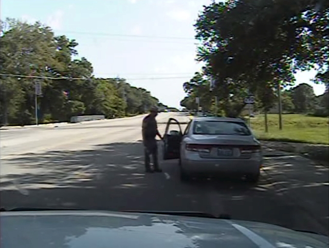 A Waller County Department of Public Safety officer opens the driver's side door as he orders Sandra Bland out of her vehicle, in this still image captured from the police dash camera video  ...