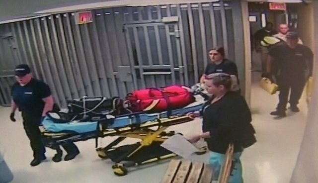 Medics leave with equipment on a stretcher at Waller County Jail in Hempstead, Texas, July 13, 2015, in this still image taken from video provided by the Waller County Sheriff's Office. Sand ...
