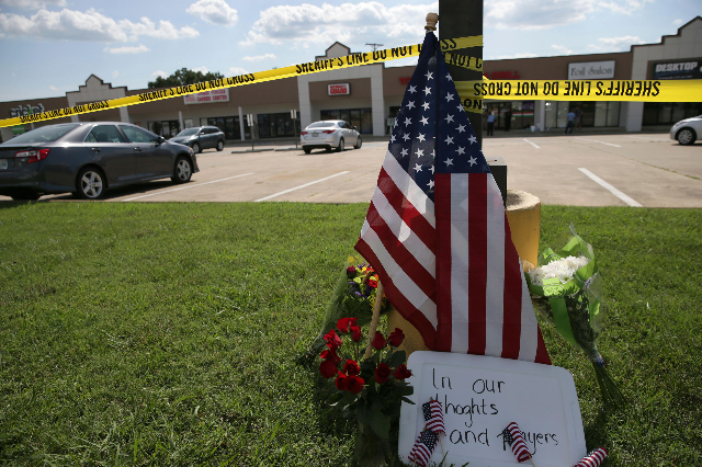 Police tape and a makeshift memorial sit on the lawn in front of an Armed Forces Career Center in Chattanooga, Tennessee, July 16, 2015. (Damon J. Moritz/U.S. Navy/Handout/Reuters)
