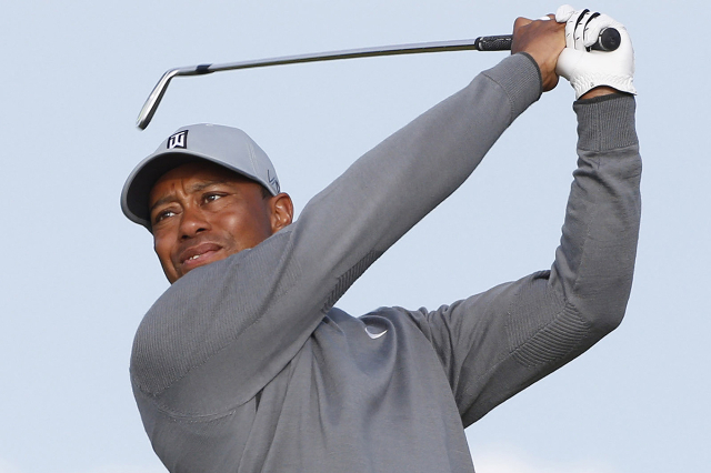 Jul 13, 2015; St. Andrews, Scotland, GBR; Tiger Woods tees off on the 11th hole during a practice round for the 144th Open Championship at Royal and Ancient Golf Club of St Andrews. (Brian Spurloc ...