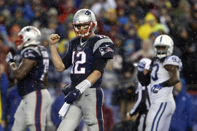 Jan 18, 2015; Foxborough, MA, USA; New England Patriots quarterback Tom Brady (12) pumps his fist as he heads up to the line against the Indianapolis Colts in the second half in the AFC Championsh ...
