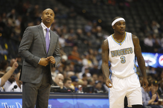 Feb 25, 2015; Denver, CO, USA; Denver Nuggets head coach Brian Shaw and guard Ty Lawson (3) during the first half against the Phoenix Suns at Pepsi Center. (Chris Humphreys-USA TODAY Sports)