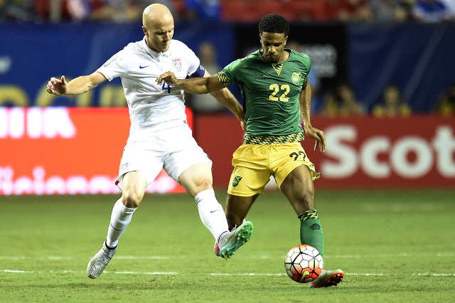 Jul 22, 2015; Atlanta, GA, USA; Jamaica midfielder Garath McClearly (22) tries to maintain control defended by United States midfielder Michael Bradley (4) in the second half during the CONCACAF G ...