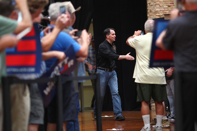 Wisconsin Gov. Scott Walker, a Republican presidential candidate, greets supporters during a campaign stop at Harley-Davidson, 2260 S. Rainbow Blvd., in Las Vegas on Tuesday, July 14, 2015. (Chase ...