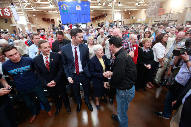 Wisconsin Gov. Scott Walker, a Republican presidential candidate, center right, greets supporters during a campaign stop at Harley-Davidson, 2260 S. Rainbow Blvd., in Las Vegas on Tuesday, July 14 ...