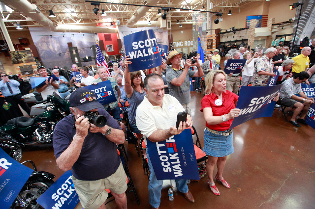 People cheer as Wisconsin Gov. Scott Walker, a Republican presidential candidate, speaks during a campaign stop at Harley-Davidson, 2260 S. Rainbow Blvd., in Las Vegas on Tuesday, July 14, 2015. ( ...