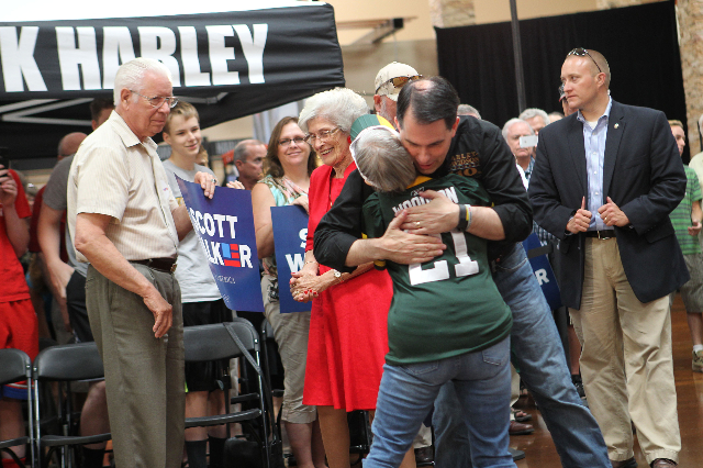Wisconsin Gov. Scott Walker, a Republican presidential candidate, greets a supporter before speaking during a campaign stop at Harley-Davidson, 2260 S. Rainbow Blvd., in Las Vegas on Tuesday, July ...