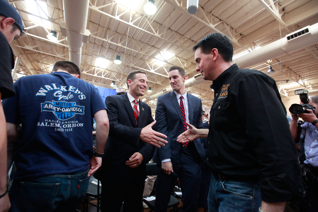Nevada Attorney General Adam Laxalt, second from left, greets Wisconsin Gov. Scott Walker, a Republican presidential candidate, far right, during a campaign stop at Harley-Davidson, 2260 S. Rainbo ...