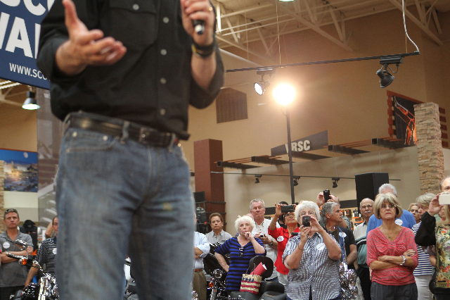 People listen as Wisconsin Gov. Scott Walker, a Republican presidential candidate, speaks during a campaign stop at Harley-Davidson, 2260 S. Rainbow Blvd., in Las Vegas on Tuesday, July 14, 2015.  ...