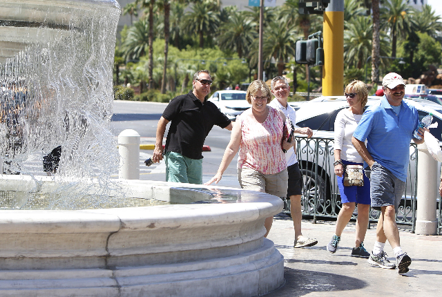 Tourists walk past the fountain on a hot day near Venetian hotel-casino on Las Vegas Boulevard Wednesday, July 29, 2015. Las Vegas should hit a high of 104 degrees, about average for a mid-summer  ...