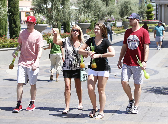 Tourists walk on a hot day on the Strip near Venetian hotel-casino Wednesday, July 29, 2015. Las Vegas should hit a high of 104 degrees, about average for a mid-summer day. BIZUAYEHU TESFAYE/LAS V ...