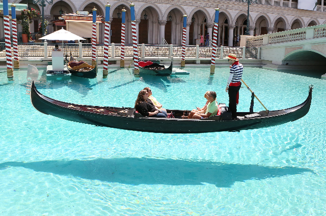Tourists take a gondola ride on a hot day at the Venetian Grand Canal Shoppes on Las Vegas Boulevard Wednesday, July 29, 2015. Las Vegas should hit a high of 104 degrees, about average for a mid-s ...