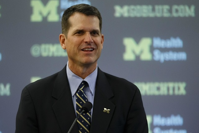 Dec 30, 2014; Ann Arbor, MI, USA; Jim Harbaugh speaks to the media as he is introduced as the new head football coach of the Michigan Wolverines at Jonge Center. (Rick Osentoski-USA TODAY Sports)