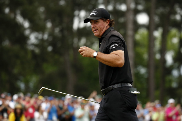 Apr 12, 2015; Augusta, GA, USA; Phil Mickelson reacts after completing the final round of The Masters golf tournament at Augusta National Golf Club. (Rob Schumacher-USA TODAY Sports)