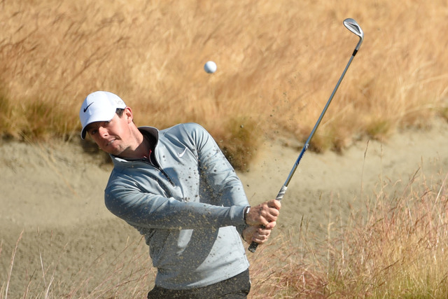 Jun 17, 2015; University Place, WA, USA; Rory McIlroy hits out of the bunker on the 15th hole during practice rounds on Wednesday at Chambers Bay. (John David Mercer-USA TODAY Sports)